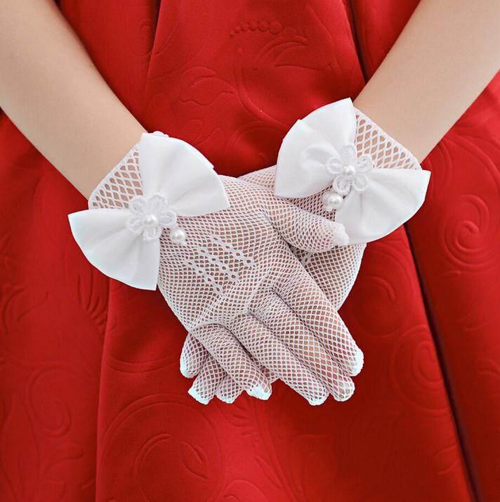 ถุงมือเด็กออกงานสีขาวตาข่ายยืด 4-15 ขวบ แบบฟรีไซส์ แต่งโบว์สวย.