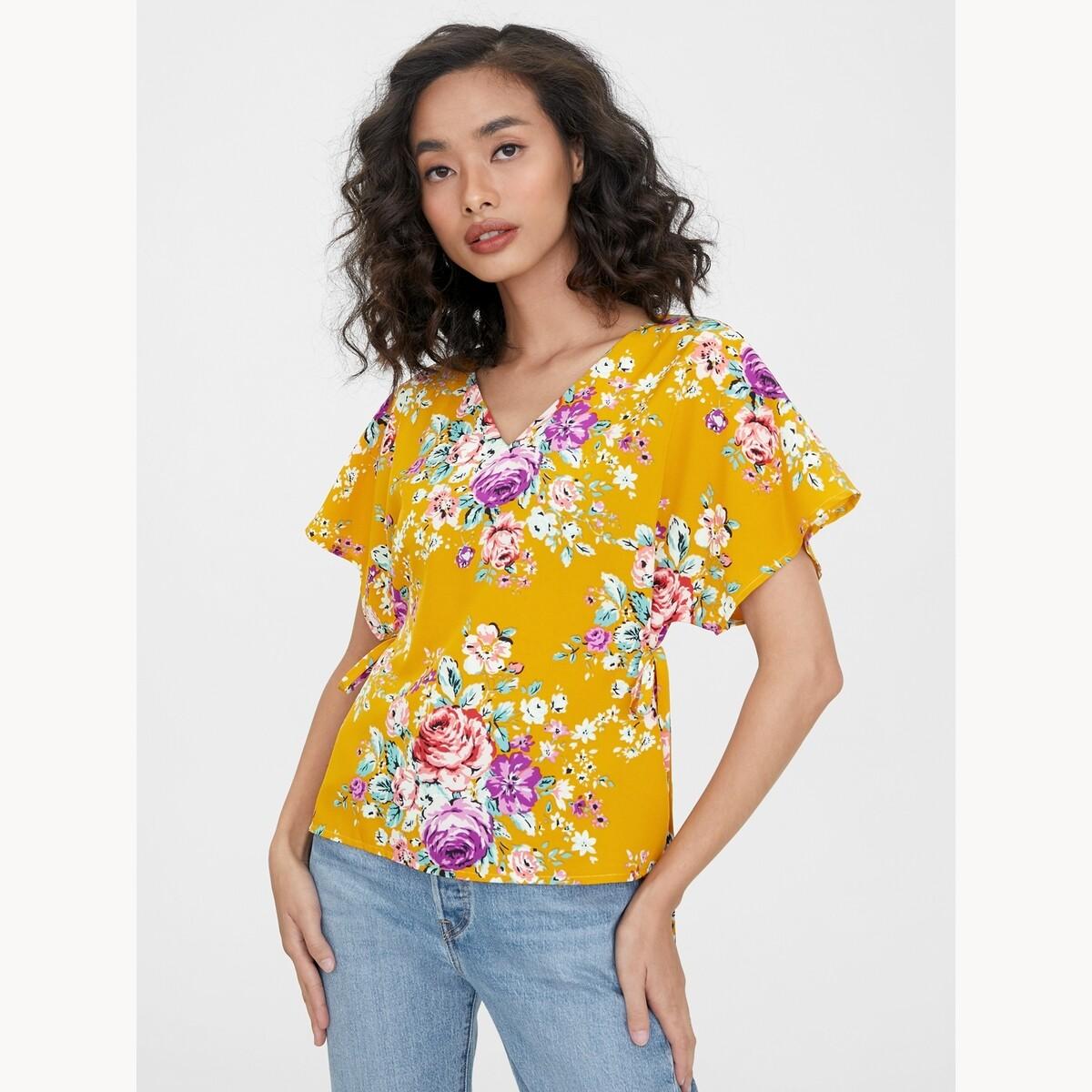 Pomelo เสื้อคอวีทรงปล่อยดีเทลกระดุมหน้าพิมพ์ลายดอกไม้ เสื้อตัวยาว ผู้หญิง.